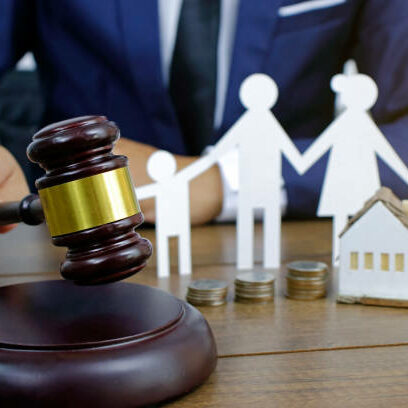 Family law concept. Family Paper and hammer on the table